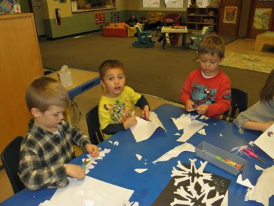 Students doing snowflake crafts