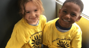 Two Kids on the Bus Smiling